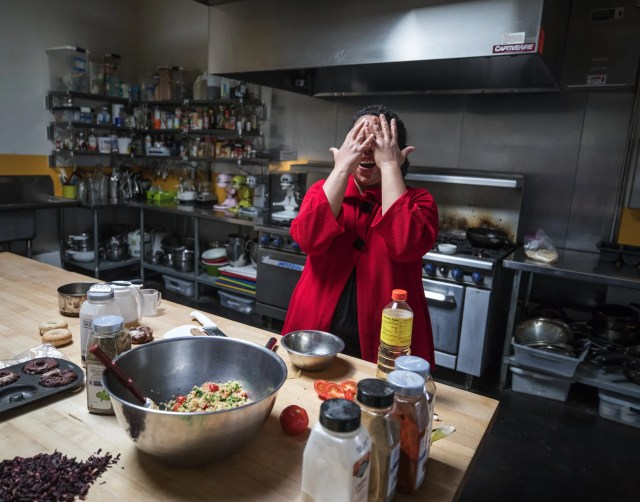 Ariel Bangs has a laugh while working in the  Coyote Central kitchen.  (Steve Ringman / The Seattle Times)