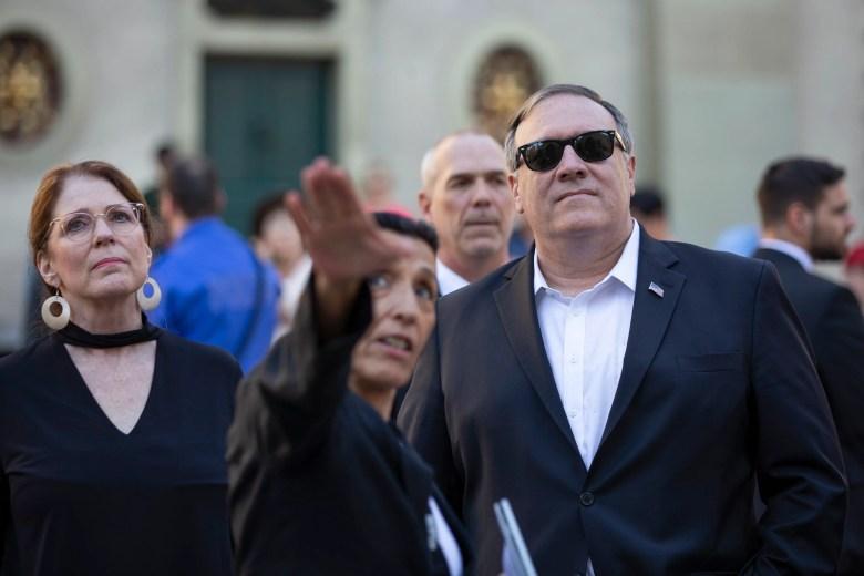 Pompeo visits elite event as Trump policies raise ...