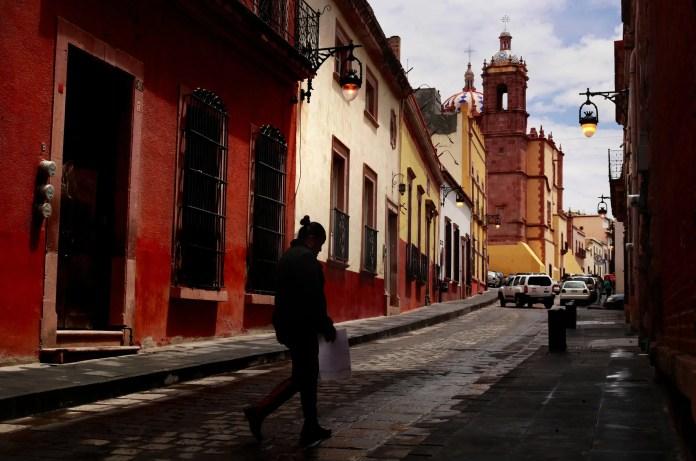 A pedestrian walks through Zacatecas. (Erika Schultz / The Seattle Times)