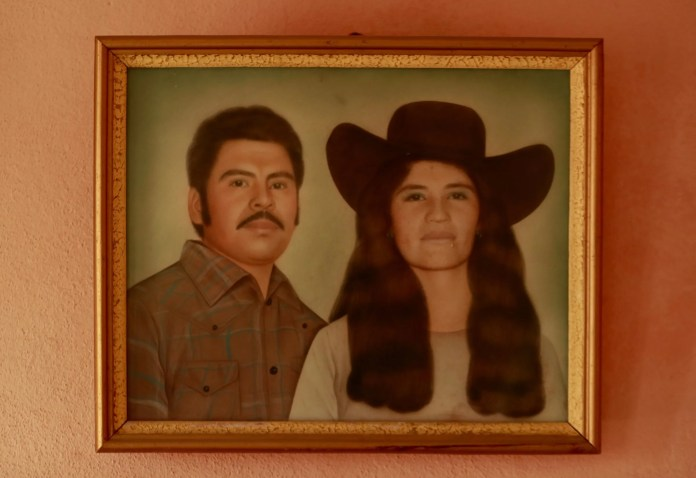 A portrait of Rafael's parents is displayed in his home in Zacatecas. (Erika Schultz / The Seattle Times)