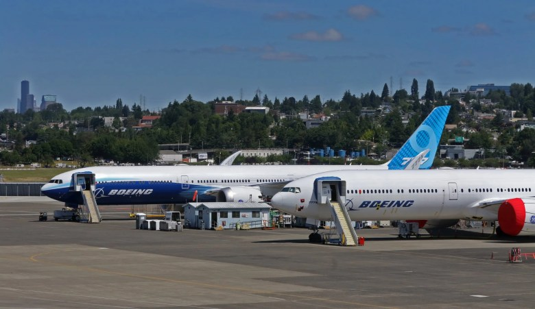 Two 777X flight-test planes are parked at Boeing Field on June 18. (Ellen M. Banner / The Seattle Times)