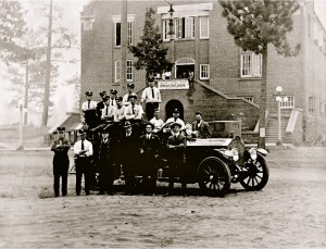 City of Bend Firefighters in front of the American Legion Building at 500 NW Wall Street.