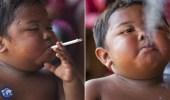 بالصور.. طفل  يعالج إدمانه للسجائر التي ادمنها وهو بعامه الثاني بطريقة غريبة
