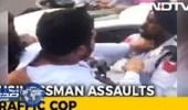 بالفيديو.. رجل أعمال يصفع شرطيا بسبب الرخصة