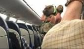 """طرد راكبة أمريكية من الطائرة لإصطحابها """" خنزير """""""