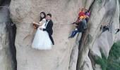 بالصور.. جلسة تصوير لعروسين صينيين أعلي جبل تشايا