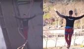 بالفيديو.. مغامر يحطم رقمًا قياسيًا بالمشي على حبل في سماء باريس