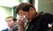 """الرئيس الفلبيني يبكي على ضحايا عاصفة """" تمبين """""""