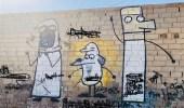 فنان مجهول يظهر موهبته برسومات كرتونية علي جدران تيماء