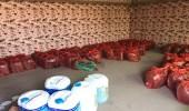 بالصور.. ضبط 2736 زجاجة عرق مسكر بالرياض 