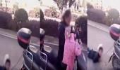 بالفيديو.. أم تسحل ابنها بدراجتها النارية
