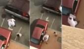 """بالفيديو.. أب يعنف ابنه بالعقال بأحد أحياء """" جدة """""""