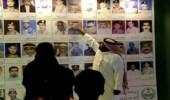 """زوار الجنادرية 32 من أمام لوحات الشهداء: """" أنتم أحياء في قلوبنا """""""