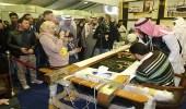كسوة الكعبة تجذب آلاف الزائرين لجناح المملكة بمعرض القاهرة للكتاب