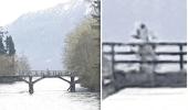 صورة غريبة لرائد فضاء يلوح بيده فوق جسر بحيرة