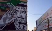 """"""" جدارية """" لصورة خادم الحرمين تزين مهرجان في عنيزة"""