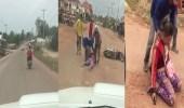 بالفيديو .. رجل يضرب زوجته أثناء قيادته دراجة نارية