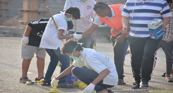 بالصور.. هيئة الرياضة واليرموك ينفذان برنامج طلاء مطبات أبوعريش