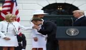 قبلة ماكرون لزوجته تحرج زوجة ترامب العبوس
