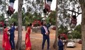 بالفيديو.. مصور يعرض حياته للخطر في جلسة تصوير عروسين