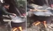 فيديو صادم لرجلين يطهيان ثعابين حية