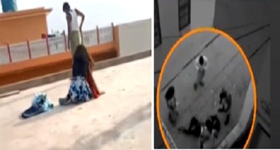بالفيديو.. أب يدفع ابنته لتلقي نفسها من أعلى سطح المنزل