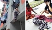 بالفيديو.. رجل يمسك سيدة من شعرها لمنع سقوطها من الطابق الثاني
