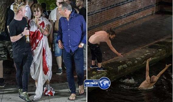 بالصور.. الإنجليز يرمون أنفسهم في القنوات المائية ويتسلقون إشارات المرور بعد الخروج من المونديال
