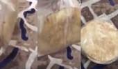 بالفيديو.. عمالة أجنبية توزع أكياس خبز مجهولة المصدر على البقالات برفحاء