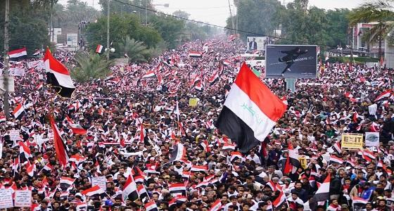 بالصور.. عراقيون يرتدون «أكفانهم» في مظاهرات حاشدة للمطالبة بخروج القوات الأمريكية