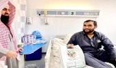 جمعية الإرشاد برفحاء توزع حقائب شتوية وهدايا للمرضى