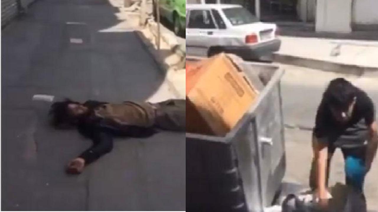 شاهد.. شاب إيراني مشرد وآخر يبحث في القمامة عن الطعام