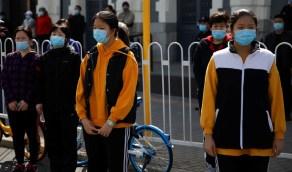 بالصور..حداد في الصين على آلاف المتوفين بالفيروس