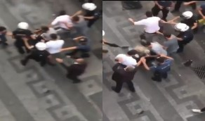 شاهد.. شرطي تركي يطلق الرصاص على رأس متظاهر كردي