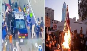 """بالفيديو والصور ..أمريكيون يحرقون العلم في مظاهرات حاشدة بسبب """"القتيل الأسود"""""""