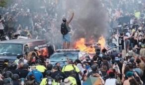 بالفيديو.. الطائرات الحربية تحلق فوق رؤوس المتظاهرين بواشنطن