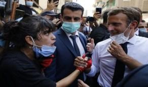 بالصور..ماكرون يحتضن فتاة لبنانية لمواساتها