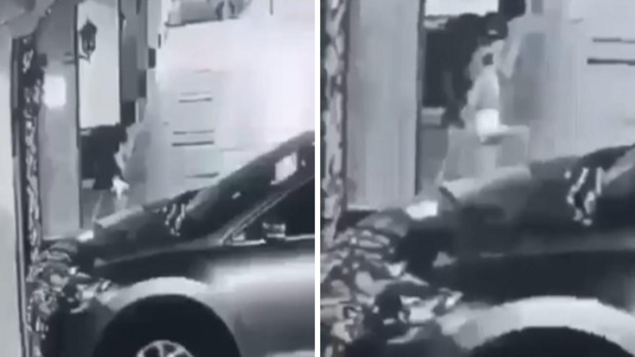 بالفيديو.. سيدة منتقبة تشعل النيران عند قدميها بغرابة وتختفي أمام أحد المنازل