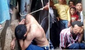 """بالفيديو.. أهالي قرية يعذبون شاب بعد اغتصابه طفله و """"يزفونه"""" بالإهانات"""