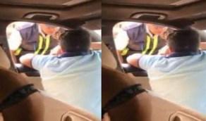 """القبض على الطفل الذي حاول دهس ضابط مرور بسيارته: """"والده قاضِ"""""""
