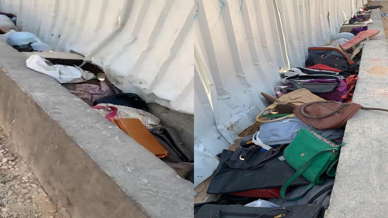 فيديو يرصد حقائب وملابس نسائية كثيرة ملقاه في شارع عام بحي البديعة