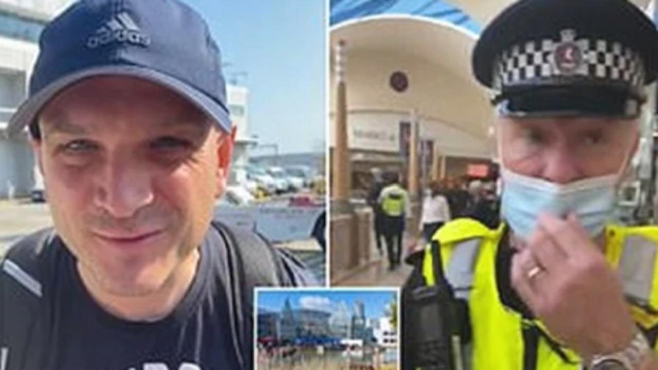 ضابط شرطة يسحل رجل لعدم ارتدائه كمامة
