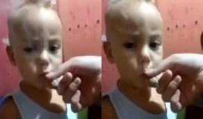 أم مستهترة تجبر طفلها على تدخين الحشيش