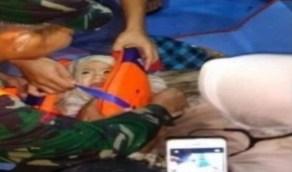 حقيقة العثور على طفل ناجي من تحطم الطائرة الإندونيسية