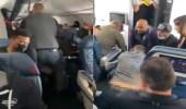 بالفيديو.. لحظة محاولة مسافر اقتحام قمرة القيادة أثناء رحلة جوية