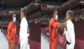 بالفيديو.. مدرب يجر لاعبته بقوة قبل بدء نزالات الجودو