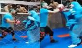 """شاهد.. فتاة """"محجبة"""" تؤدي  تمرين الملاكمة أمام مدربها بمهارة عالية"""
