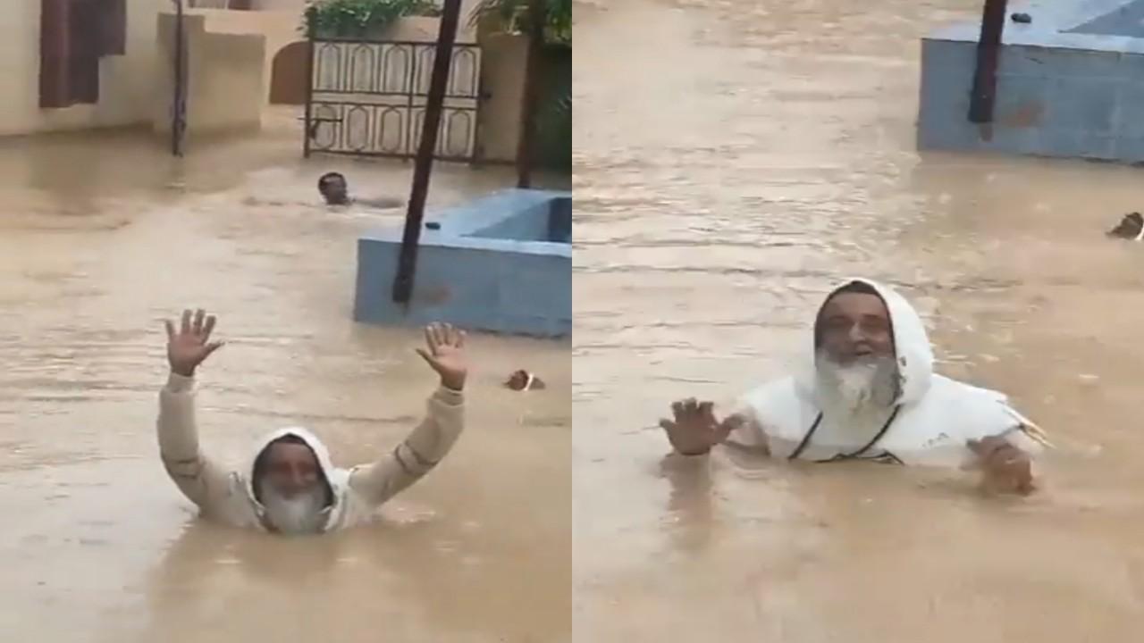 بالفيديو.. مسن عماني يسبح في مياه غمرت منزله بعد إعصار شاهين
