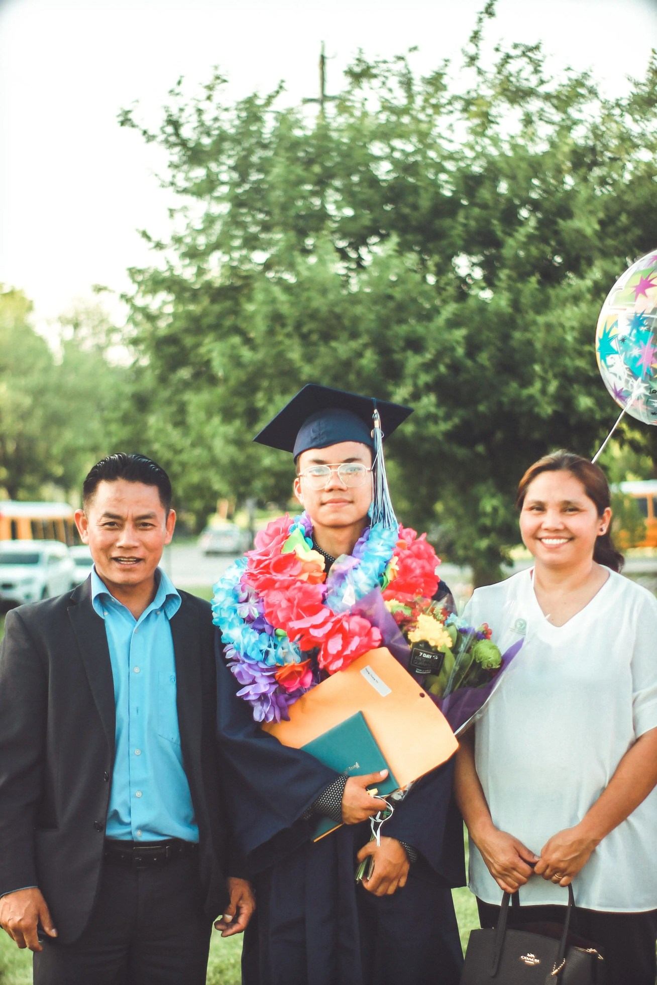 https://www.pexels.com/photo/photo-of-a-man-wearing-academic-gown-together-with-his-parents-2513989/