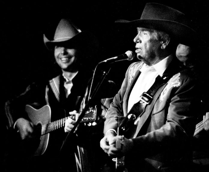 ME.0325.OWENS.3 – 1991 file photo of Dwight Yoakam (l) and Country music statesman Buck Owens perfor